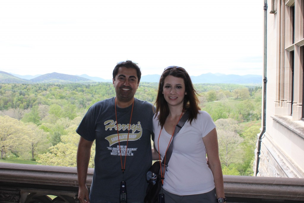 The background shows the rolling hills behind the Biltmore estate in Asheville, NC